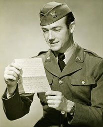 World War II soldier reading a letter (Hulton Archive)
